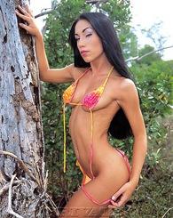 Exotic babe in bikini shows...