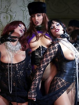 Three fetish ladies play...