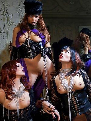 Three fetish ladies play...